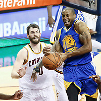 10 June 2016: Golden State Warriors forward Andre Iguodala (9) grabs the rebound over Cleveland Cavaliers forward LeBron James (23) and Cleveland Cavaliers forward Kevin Love (0) during the Golden State Warriors 108-97 victory over the Cleveland Cavaliers, during Game Four of the 2016 NBA Finals at the Quicken Loans Arena, Cleveland, Ohio, USA.