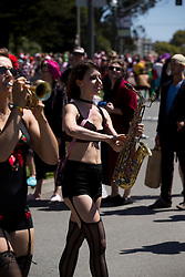 A saxophonist with the Burlesque Band of San Francisco marches through Golden Gate Park, during the 105th running of the Bay to Breakers 12k, Sunday, May 15, 2016 in San Francisco. The 7.42-mile race from San Francisco Bay to the Pacific Ocean, which attracts a field of tens of thousands of runners, from elite runners to weekend warriors, some clad in costume and some in nothing at all. (D. Ross Cameron/Bay Area News Group)