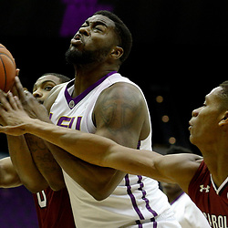 Feb 1, 2017; Baton Rouge, LA, USA; South Carolina Gamecocks guard PJ Dozier (15) and guard Sindarius Thornwell (0) defend LSU Tigers center Elbert Robinson III (3) during the first half of a game at the Pete Maravich Assembly Center. Mandatory Credit: Derick E. Hingle-USA TODAY Sports