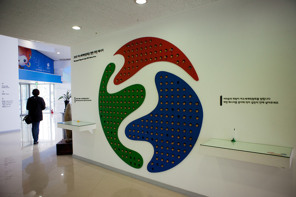 "The Expo 2012 logo at the information center in the South Korean city. Yeosu will host the Expo 2012 exhibition  under the theme ""The Living Ocean and Coast"". Yeosu (Yeosu-si) is a city in South Jeolla Province. Old Yeosu City, which was founded in 1949, Yeocheon City, founded in 1986, and Yeocheon County were merged into a new city in 1998."