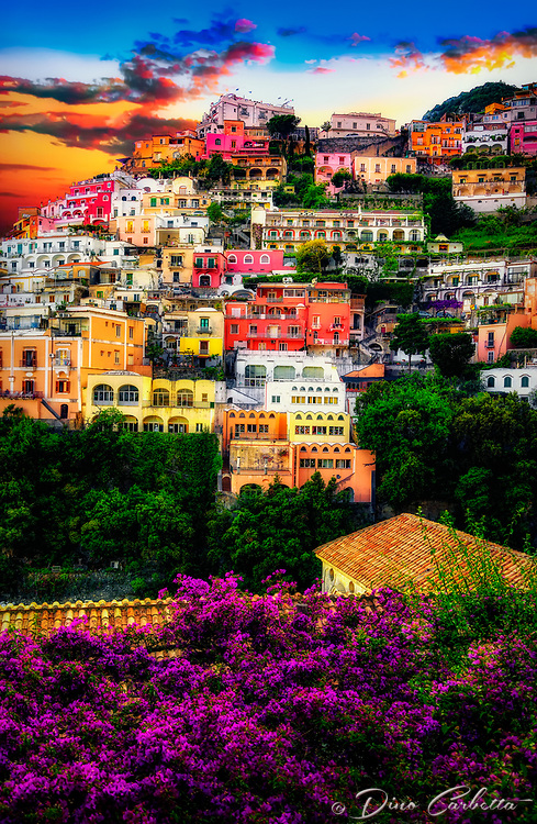 """""""Bougainvillea anticipates sunset above Positano cliff side""""…<br /> <br /> As the sun set on the second exhilarating day in Positano, the villas and flowers posed graciously one last time for this weary photographer. All indications seemed to verify that late May in Positano presented a spectacular pallet of every color under God's rainbow. This quaint seaside village stimulated one's senses, aggrandizing its chest and boasting specular perfection. I cannot imagine a more benevolent time of year than during late spring to visit the bellissimo Amalfi coast. This image was my last of the evening before a long hike up to the terrace of Hotel Montemare's famous restaurant. Finally, time to relax and unwind while admiring yet another truly breathtaking sea view of Positano Bay."""