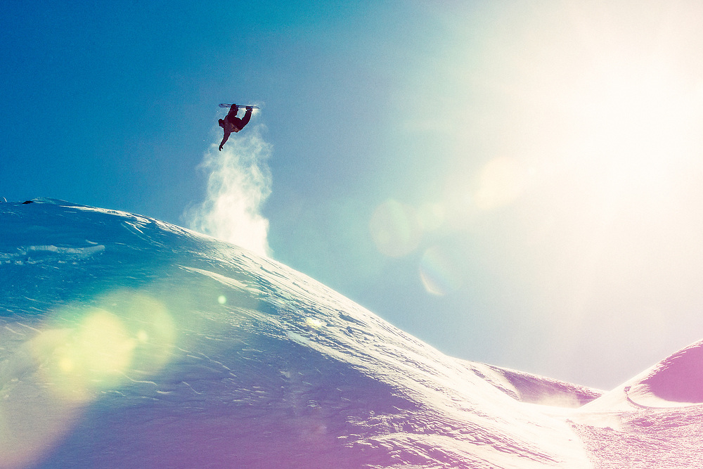 Professional snowboarder Jake Blauvelt performs a backside rodeo on his snowboard while filming for his movie titled Jake Blauvelt Naturally.