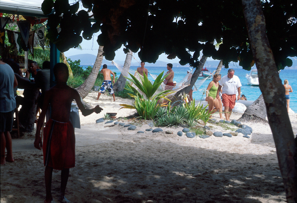 A boy plays the ring game at the Soggy Dollar Bar at Sandcastle Resort, Jost Van Dyke, British Virgin Islands.