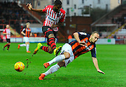 Exeter City's Joel Grant is tackled by during the Sky Bet League 2 match between Exeter City and Luton Town at St James' Park, Exeter, England on 19 December 2015. Photo by Graham Hunt.