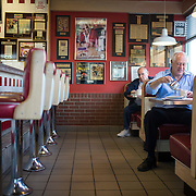 6:49 am: Gov. Pat Quinn has cereal and hot water for breakfast at White Palace Grill in Chicago on Wednesday, Sept. 3, 2014. Quinn made seven campaign stops across the state of Illinois while sticking to his minimum wage budget.   (Brian Cassella/Chicago Tribune)