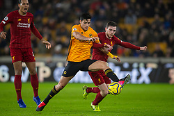 WOLVERHAMPTON, ENGLAND - Thursday, January 23, 2020: Wolverhampton Wanderers' Raúl Jiménez (L) and Liverpool's Andy Robertson during the FA Premier League match between Wolverhampton Wanderers FC and Liverpool FC at Molineux Stadium. (Pic by David Rawcliffe/Propaganda)