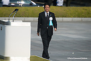 Japan, Hiroshima : HIROSHIMA, JAPAN - AUGUST 06: Japanese Prime Minister Shinzo Abe walks to give a speech during the 70th anniversary ceremony of the atomic bombing of Hiroshima at the Hiroshima Peace Memorial Park on August 6, 2015 in Hiroshima, Japan. Japan marks the 70th anniversary of the first atomic bomb that was dropped by the United States on Hiroshima on August 6, 1945. The bomb instantly killed an estimated 70,000 people and thousands more in coming years from radiation effects. Three days later the United States dropped a second atomic bomb on Nagasaki which ended World War II.
