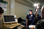 Aaron Overturn displays his solar panel that will automatically adjust angle and swivel to best absorb the suns' rays. This helps maximize the efficency of the panels, which is still relatively low compared to what is phycially possible.