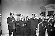 13/02/1963<br /> 02/13/1963<br /> 13 February 1963<br /> Retirement presentation at Gilbeys of Ireland Ltd., Dublin. A presentation of a cheque for £100 and a gold watch was made to Paddy Slater (65), on his retirement after 49yrs and 7 months service with the company. A sum of money was also presented by the staff. Picture shows: Mr. Ian Cairnduff, Director Gilbeys (right) making a toast to Mr. Slater, along with members of staff.