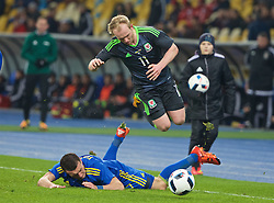 KIEV, UKRAINE - Easter Monday, March 28, 2016: Wales' Jonathan Williams is tacked against Ukraine during the International Friendly match at the NSK Olimpiyskyi Stadium. (Pic by David Rawcliffe/Propaganda)