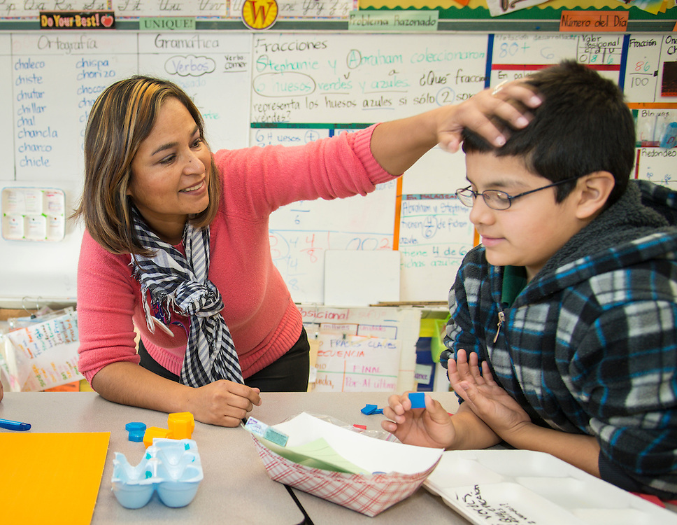 Maria Elena Galán teaches fractions to her third grade class at Scroggins Elementary School, January 14, 2014.