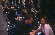 A couple enjoy an intimate moment at an outdoor cafe in central London, on 21st September 1999, near Old Bond Street, london, England.