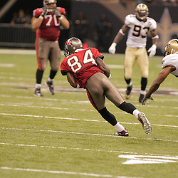2008 September 7: Joey Galloway (84) of the Tampa Bay Buccaneers catches a pass in front of Tracy Porter (22) of the New Orleans Saints during their game at the Louisiana Superdome in New Orleans, LA.  The New Orleans Saints (1-0) defeated the Tampa Bay Buccaneers (0-1) 24-20.