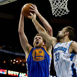 Mar 18, 2013; New Orleans, LA, USA; Golden State Warriors power forward David Lee (10) shoots over New Orleans Hornets power forward Ryan Anderson (33) during the second half of a game at the New Orleans Arena. The Warriors defeated the Hornets 93-72.  Mandatory Credit: Derick E. Hingle-USA TODAY Sports