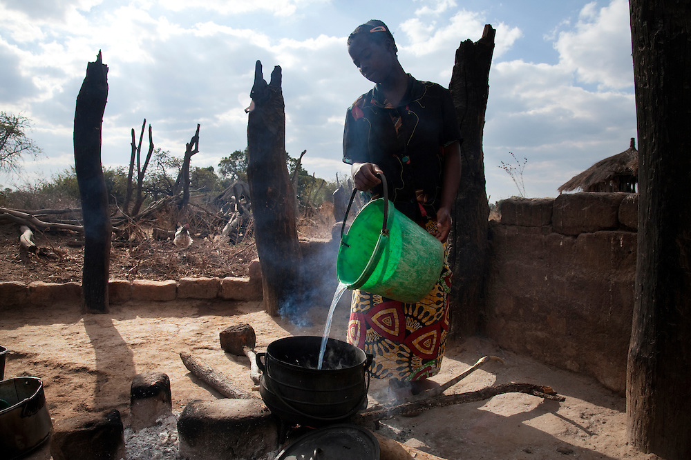 14 year old Dimitria Lubinga, 14, lives with her grandomother Jessica Mwiinga, husband Jobo, teenage granddaughter Dimitria and cousins Natasha and Miaba, as well as 9 other family members. They have to walk far for water. Habeenzu village, Zambia.