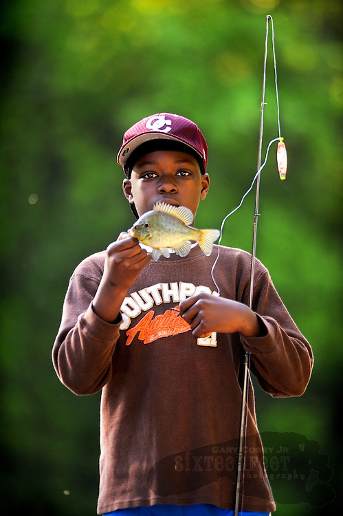 Photo by Gary Cosby Jr.  Montez Kennedy shows off his 13th catch of the day while fishing in Point Mallard Wednesday afternoon.