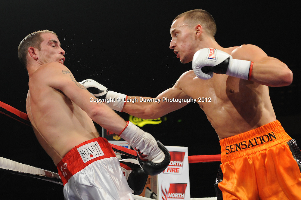 Sam O'maison defeats Johnny Greaves in a Lightweight contest at the Motorpoint Arena, Sheffield, United Kingdom on the 7th July 2012. Promoted by Matchroom Sport. ©Leigh Dawney Photography 2012.