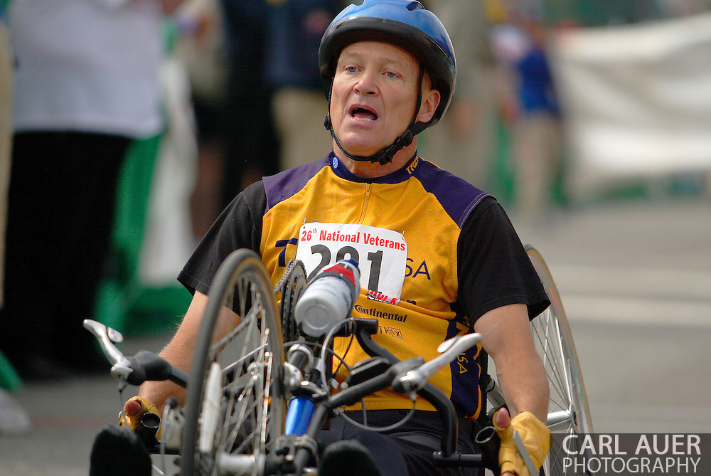 July 4th, 2006:  Anchorage, Alaska - David Nau (201), a Army veteran from Perry, Ohio, rests after crossing the finish line in the 5k Handcycle Race at the 26th National Veterans Wheelchair Games.