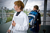 Photographs of lifestyle on the South Waterfront area of Portland, Oregon.  OHSU doctor riding in the aerial tram.
