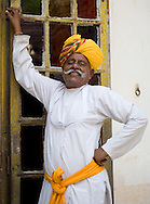 A man wearing a colourful turban at the Meherangarth Fort in Jodhpur, Rajasthan, India