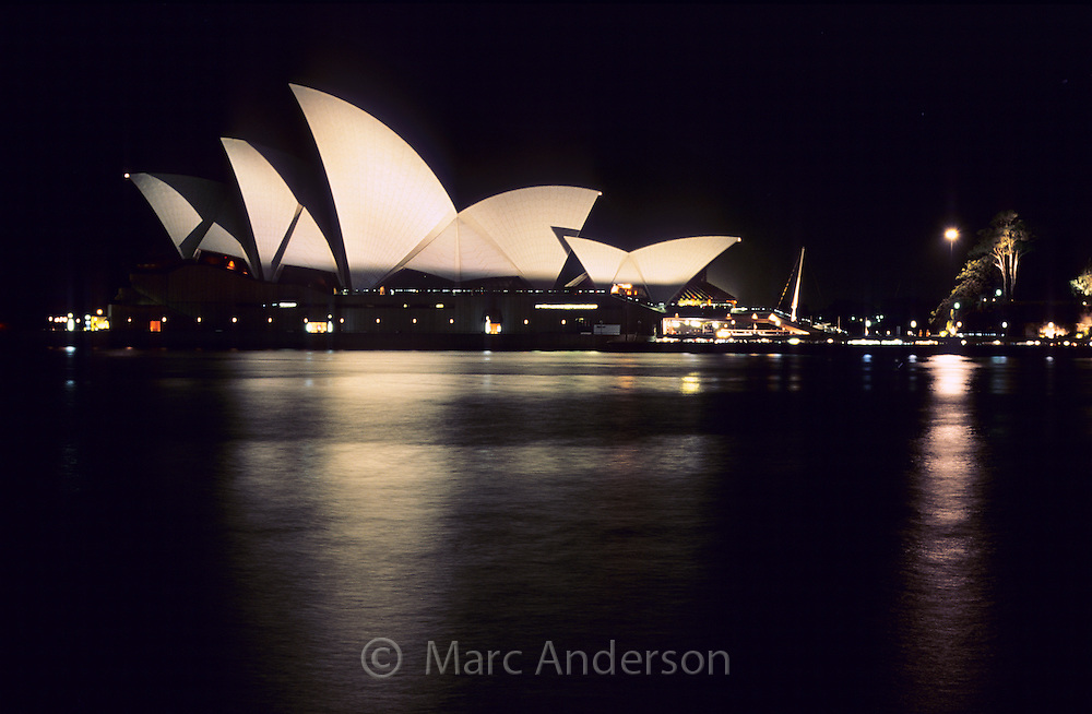 Sydney Opera House at night with reflections in the water, Sydney, Australia.