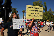 "Dee Hill-Zuganelli, (left), and Teena Cross, along with about 1,000 demonstrators, participate in Occupy Tucson at Military Plaza in Armory Park, Tucson, Arizona, USA.  The Occupy Tucson organizers created the movement in solidarity with the Occupy Wall Street movement in New York and the Occupy Together movement across the USA.  Hill-Zuganelli said, ""This is about the 99%.  All colors and ages are here.  I am glad people are standing up against the economic elite.""  Coss said, ""I am here because I believe in the fact that Wall Street has taken over and we the people who support the government are being left in the dust.""..The leaders of this movement are the everyday people participating in a movement with many de-centralized goals, with an over-arching theme of protesting government corruption from corporate money and national income disparity. We use a tool called the ""General Assembly"" to facilitate open, participatory and horizontal organizing between members of the public. We welcome people from all colors, genders and beliefs to participate in our movement. .."