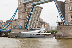 © Licensed to London News Pictures. 13/05/2018. London, UK. Alan Sugar takes photographs as he sails his luxury superyacht, Lady A on the River Thames this afternoon as it passes under Tower Bridge and parades in the Upper Pool in central London, before passing under Tower Bridge again and travelling east along the river. Alan Sugar reportedly purchased the 181 feet long yacht in 2015 and renamed her Lady A after his wife, Ann and it includes a jacuzzi and can sleep up to 12 guests. Lady A is reportedly still up for sale at around £13m after being put on the market last year, or it can be chartered with prices starting from around £12,500 per week. . Photo credit: Vickie Flores/LNP