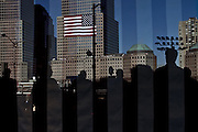 Mourners pause for a moment of silence while viewing Ground Zero on the fifth anniversary of the September 11 terrorist attacks, New York.