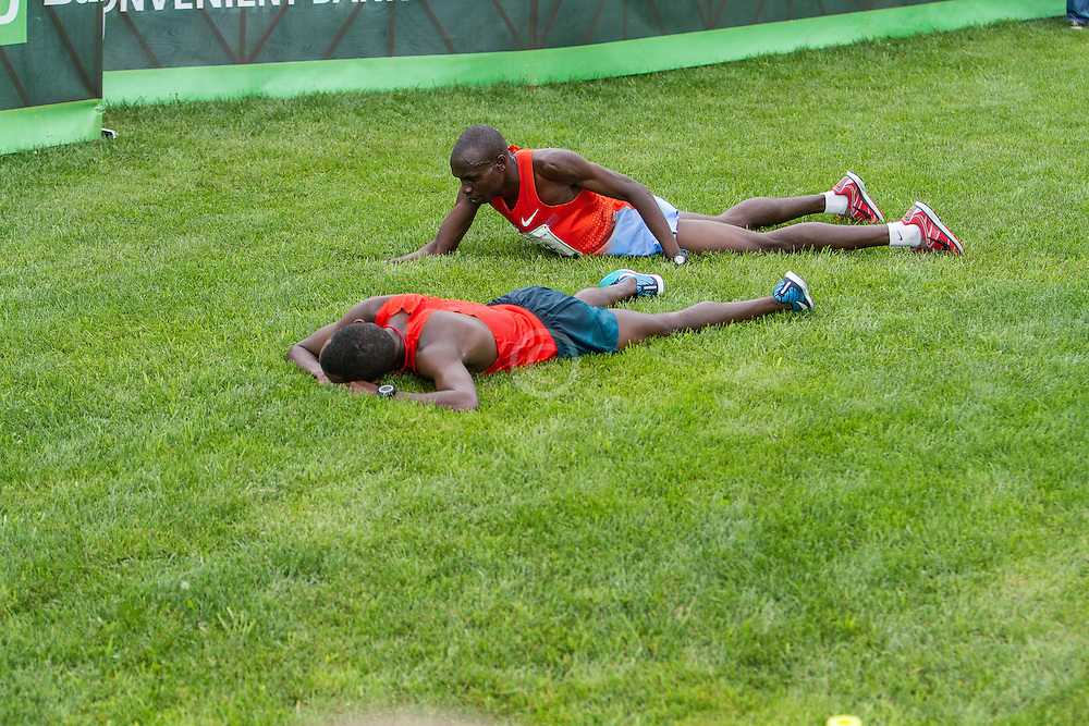 Beach to Beacon 10K: Bedan Karoki Muchiri, winner, lays in grass after finishing, with runner up Stephen Kosgei Kibet