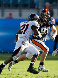 Virginia defensive end Chris Long (91) contains and then tackles Texas Tech defensive back De'Shon Sanders (21).  The Texas Tech Red Raiders defeated the Virginia Cavaliers 31-28 in the 2008 Konica Menolta Gator Bowl held at the Jacksonville Municipal Stadium in Jacksonville, FL on January 1, 2008.