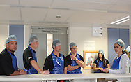 Dr Sharon Cox shows members of the Engen Extreme Racing Team the new isolation wards during the gift handover by the Engen Extreme Racing Team to children in the new burn unit of the Red Cross Children's Hospital in Cape Town, South Africa on 29 September. Photo by Jacques Rossouw/SPORTZPICS