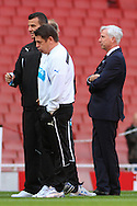 Alan Pardew , Manager of Newcastle United (right) who can return to the dug out following a 7 match touchline ban, before the Barclays Premier League match at the Emirates Stadium, London<br /> Picture by David Horn/Focus Images Ltd +44 7545 970036<br /> 28/04/2014