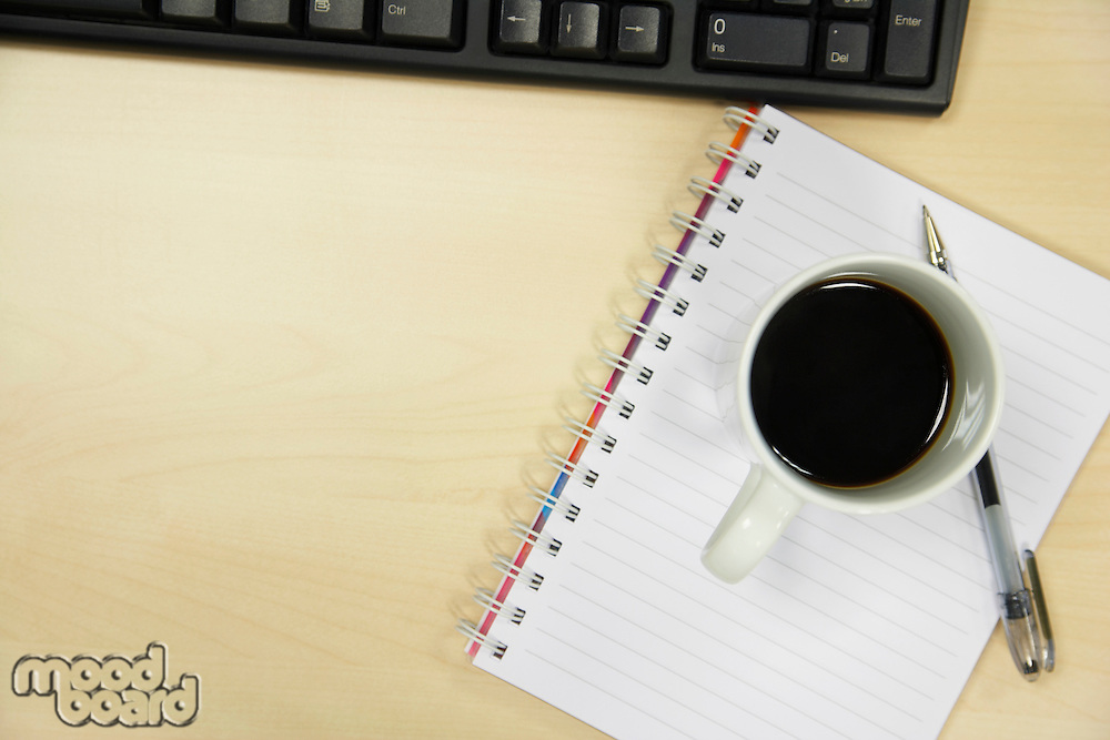 Coffee and Notebook on Desk