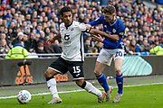 Wayne Routledge of Swansea City is challenged by Gavin Whyte of Cardiff City during the EFL Sky Bet Championship match between Cardiff City and Swansea City at the Cardiff City Stadium, Cardiff, Wales on 12 January 2020.