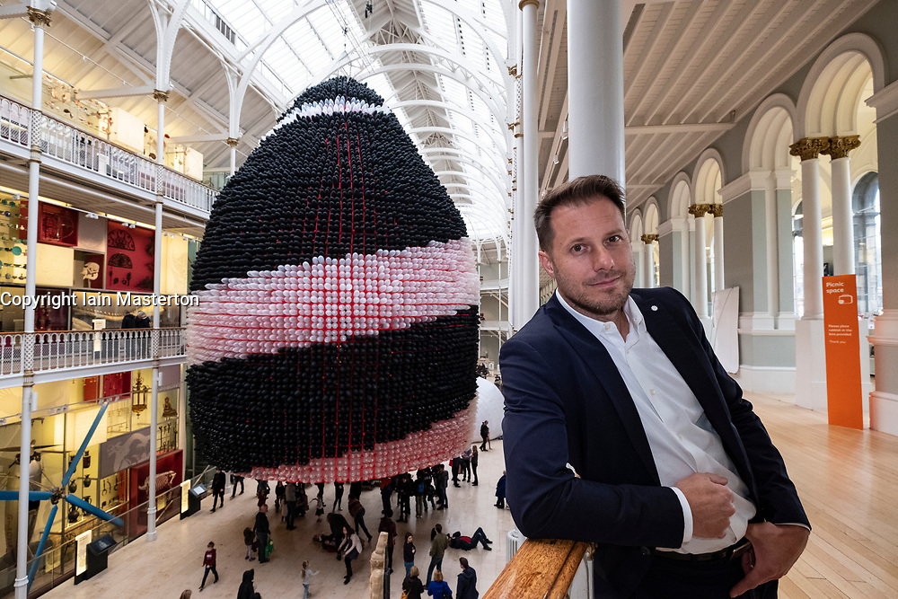 Edinburgh, UK. 6 April, 2018. Event Horizon balloon sculpture unveiled at National Museum of Scotland. American artist Jason Hackenwerth returns to Edinburgh with his biggest creation yet: a 30,000 strong balloon sculpture hanging from the top of the National Museum of Scotland&rsquo;s Grand Gallery. This will be currently the biggest balloon sculpture in the world.<br /> The installation is part of Edinburgh International Science Festival.