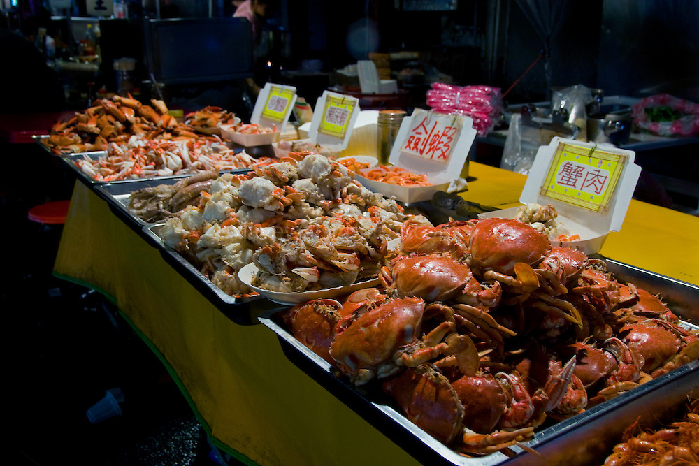 Crabs and other seafood, in the Miaokou Night Market, Keelung, Taiwan