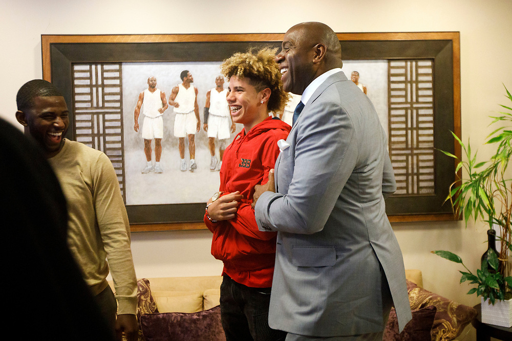 Magic Johnson and LaMelo Ball laugh together before the introduction of Lakers draft pick Lonzo Ball at the Laker's Practice Facility on Friday, June 23, 2017 in El Segundo, California. The Lakers selected Lonzo Ball as the No. 2 overall NBA draft pick and is the son of LaVar Ball. © 2017 Patrick T. Fallon
