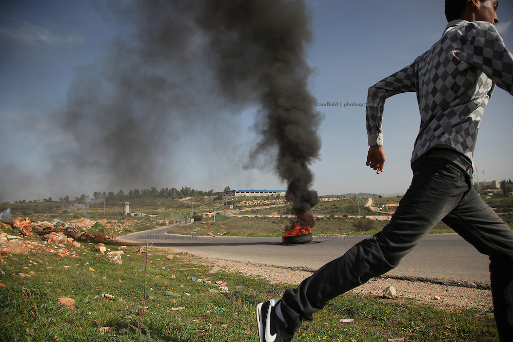 After noon prayer hundred palestinian, israeli and international protesters demonstrate in the Westbank village Nabi Saleh against land grab by israeli settlers. Some protesters respond israeli teargas, fired by soldiers,  by stone throwing stones.