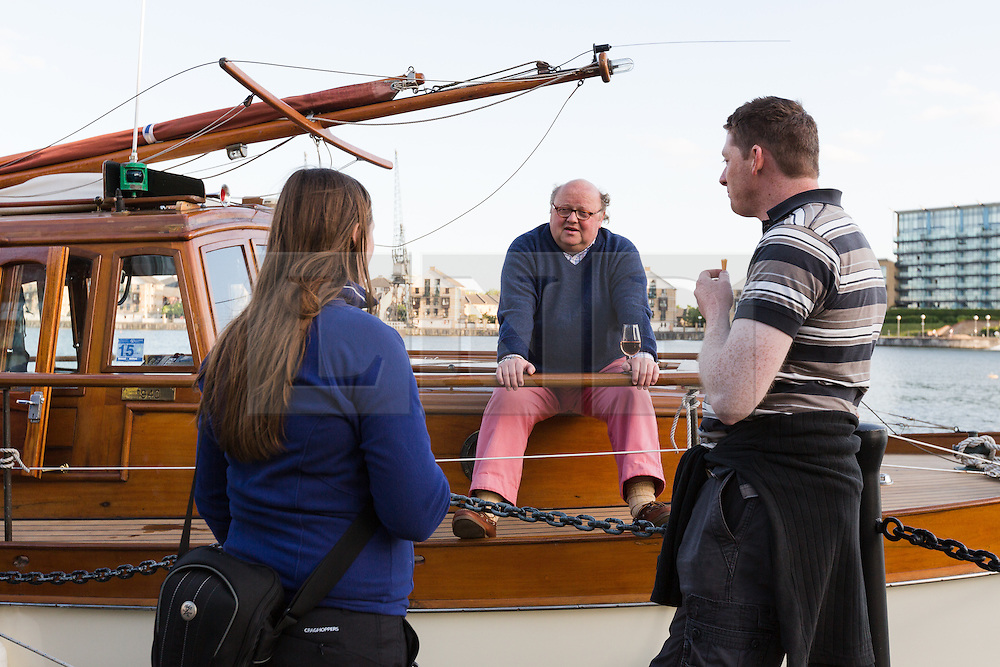 © Licensed to London News Pictures. 16/05/2015. London, UK. Owner and skipper of Dunkirk Little Ship, Hilfranor, Simon Palmer chats to visitors from his ship. Over 20 Dunkirk Little Ships have gathered in London toay before leaving in the morning to continue their journey to Dunkirk to mark the 75th anniversary of the Dunkirk Evacuations. Photo credit : Vickie Flores/LNP
