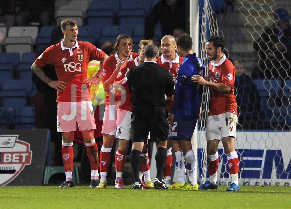 Bristol City's Adam El-Abd and team mates protest against the penalty - Photo mandatory by-line: Dougie Allward/JMP - Mobile: 07966 386802 - 08/11/2014 - SPORT - Football - Gillingham - Priestfield Stadium - Gillingham v Bristol City - FA Cup - Round One
