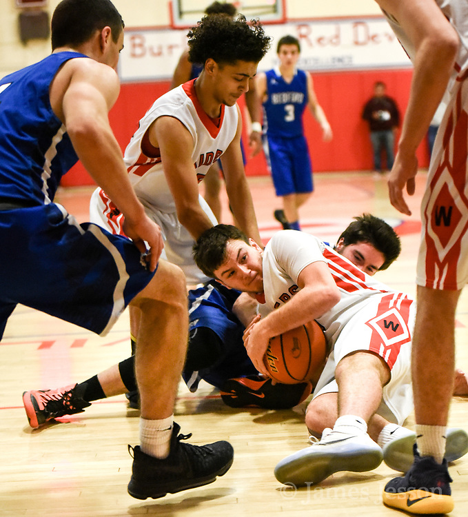 Watertown High School senior Isaac Huff tries to keep possession of the ball during the MIAA Division 3 North Sectional Final game against Bedford High School at Burlington High School, March 11, 2017. The Raiders won, 59-52.    [Wicked Local Photo/James Jesson]