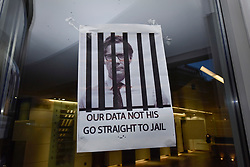 © Licensed to London News Pictures. 20/03/2018. LONDON, UK.  A poster outside the building which houses the offices of Cambridge Analytica in central London.  Cambridge Analytica, a UK based data consulting firm, has been accused of using the personal data of 50m Facebook users to influence the 2016 US presidential election.  The UK Information Commissioner is seeking a court warrant to search the premises for evidence of any breaches of the Data Protection Act.  Photo credit: Stephen Chung/LNP