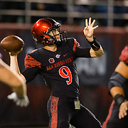 12 October 2018: San Diego State Aztecs quarterback Ryan Agnew (9) drops back to pass in his own end zone late in the fourth quarter with the Aztecs trailing 17-14. The Aztecs beat the Falcons 21-17 Friday night at SDCCU Stadium.
