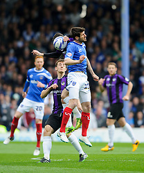 Michael Smith (NIR) of Bristol Rovers and Danny Hollands (ENG) of Portsmouth compete in the air - Photo mandatory by-line: Rogan Thomson/JMP - 07966 386802 - 19/04/2014 - SPORT - FOOTBALL - Fratton Park, Portsmouth - Portsmouth FC v Bristol Rovers - Sky Bet Football League 2.