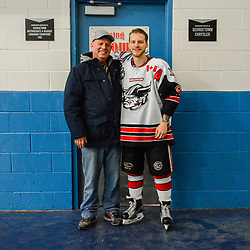 GEORGETOWN, ON - FEBRUARY 2: Jordan Crocker #9 of the Georgetown Raiders poses for a picture with his grandfather on February 2, 2019 at Gordon Alcott Memorial Arena in Georgetown, Ontario, Canada.<br /> (Photo by Michelle Malvaso / OJHL Images)