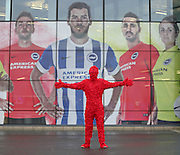 Man wearing a poppy onesie before the Sky Bet Championship match between Brighton and Hove Albion and Milton Keynes Dons at the American Express Community Stadium, Brighton and Hove, England on 7 November 2015.