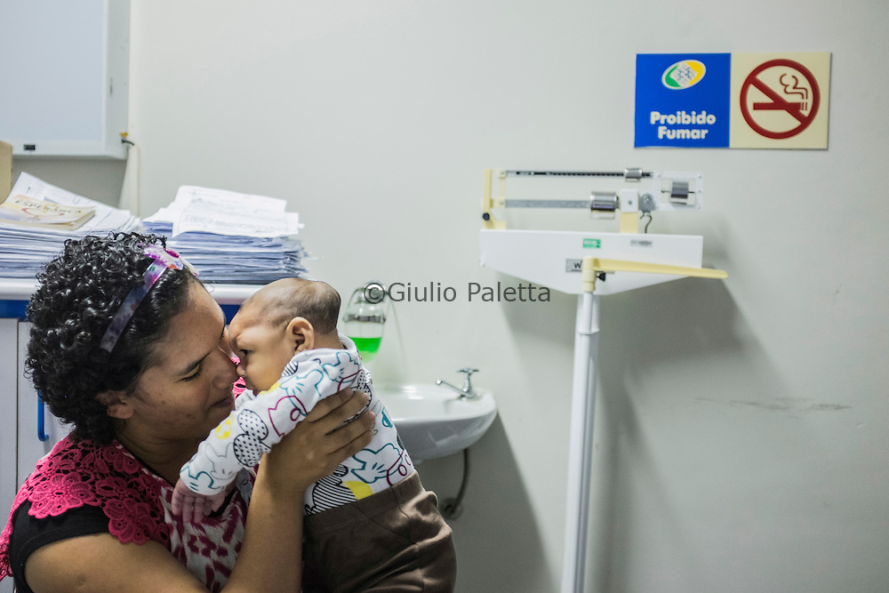 Jaqueline Vieira De Souza (25) with her son Daniel (5 months) with microcephaly, waiting the response of a pediatrician to see if she will be allowed to obtain a special pension for her son at the INSS (Social security) headquarters in Recife, Pernambuco
