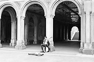 Lone banjo player at Bethesda Terrace, Central Park, New York City.