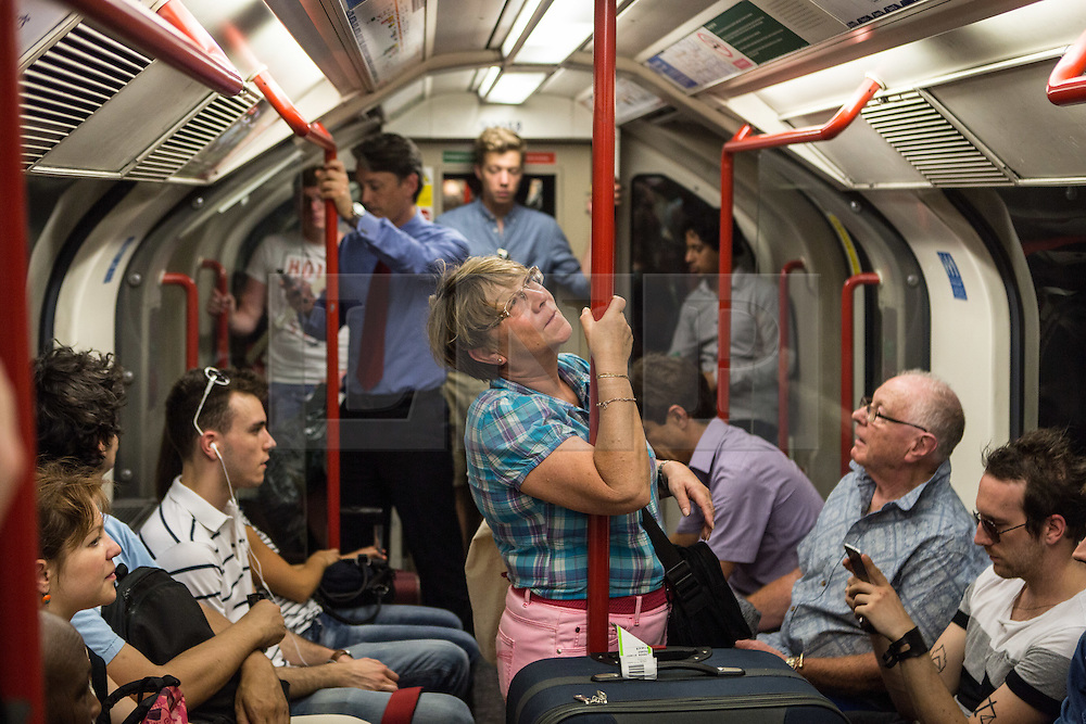 © Licensed to London News Pictures. 01/07/2015. London, UK. Commuters and tourists struggle with the intense heat on the London Underground today (01/07) on what is set to be the hottest day this decade. Photo credit : James Gourley/LNP