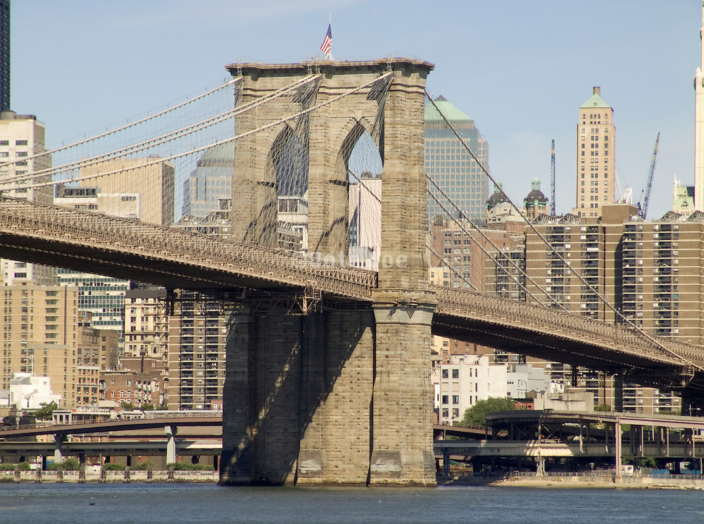 View of the Brooklyn Bridge with the downtown Manhattan in the background